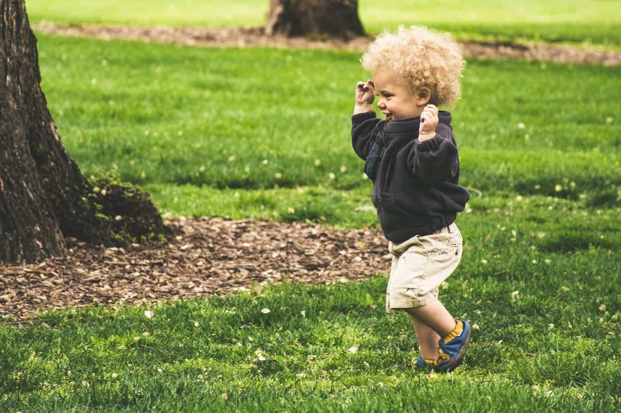 baby running outside