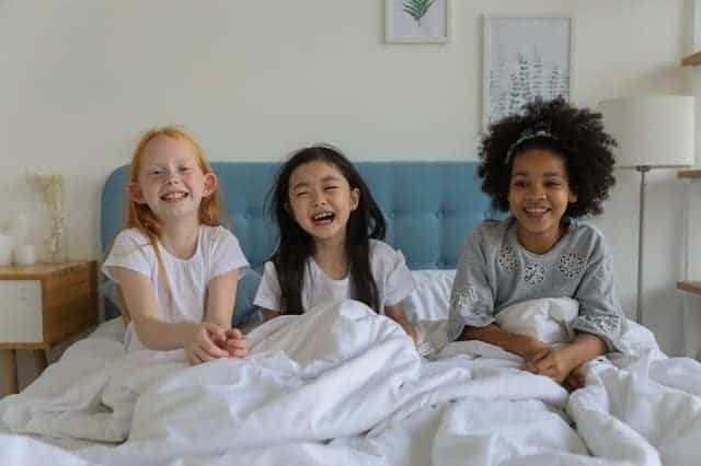 kids smiling bed