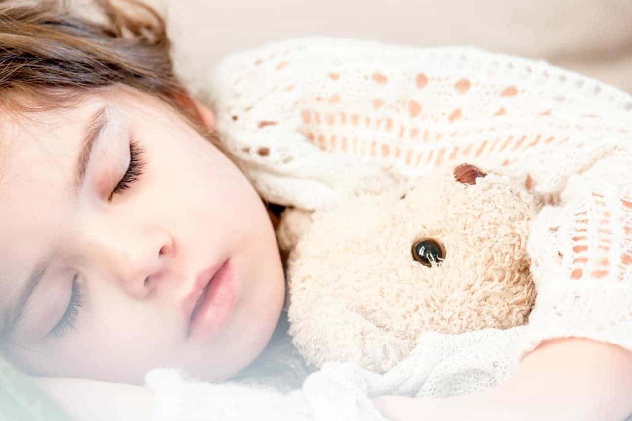 napping baby stuffed toy