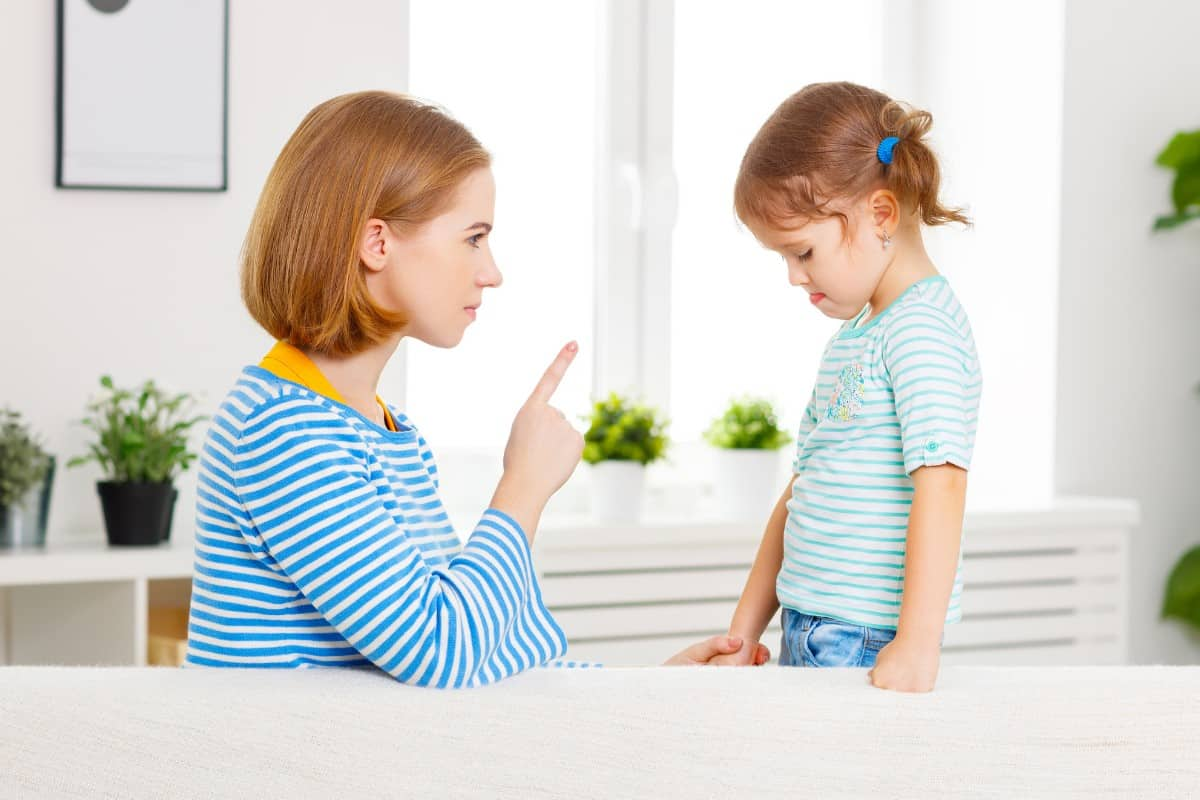 mom correcting child