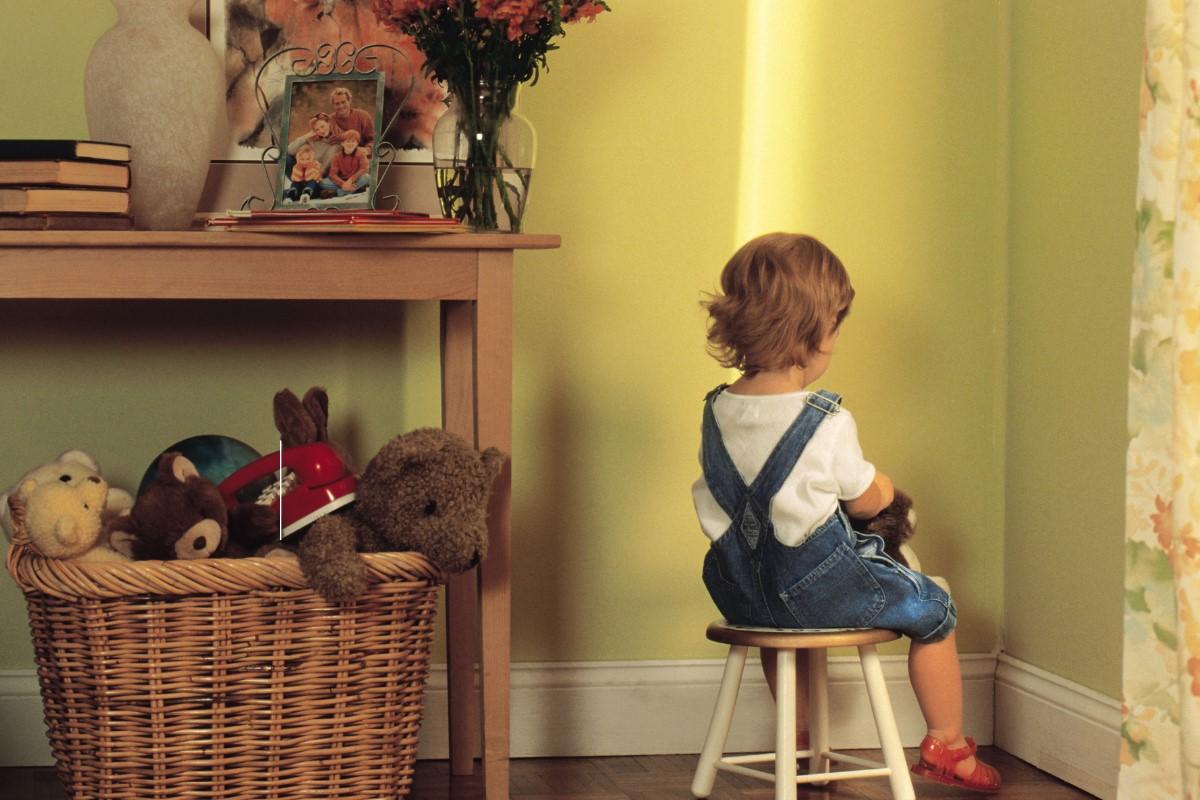 kid facing wall